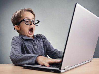 Shocked boy looking at laptop screen