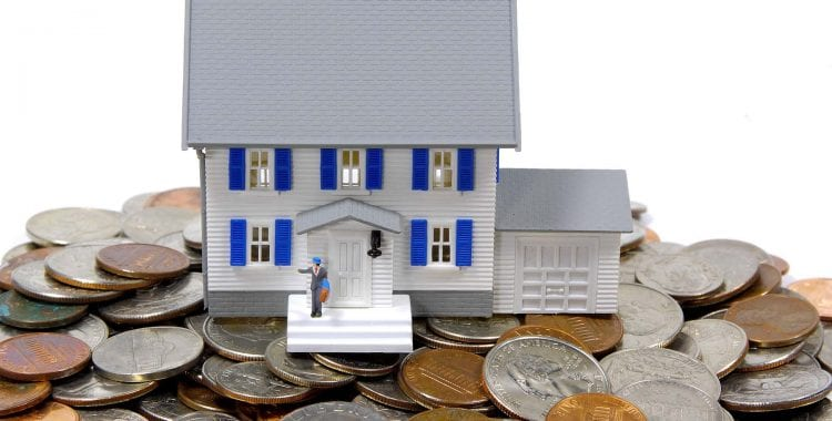 Small house on top of loose change