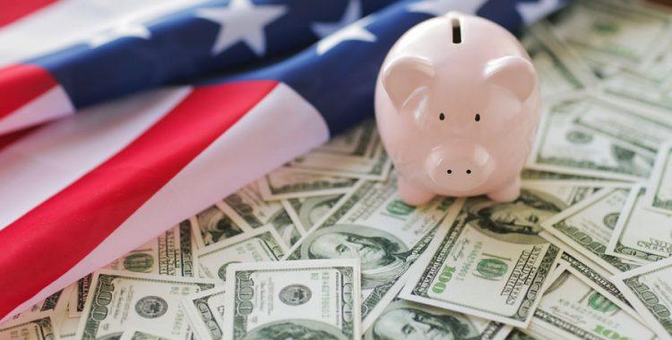 Piggy Bank with money around it