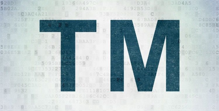 Trademark Initials in Blue Text