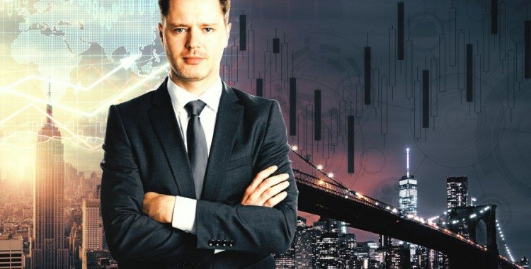 Business Man smiling with arms crossed in front of city scape with multiple graphics overlayed