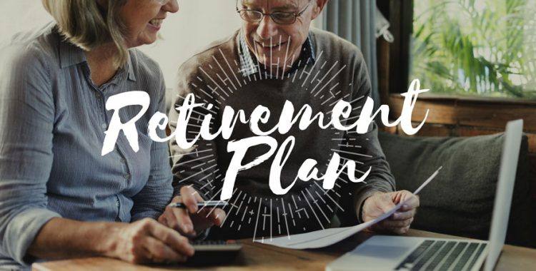 Elderly people smiling looking at paperwork with text