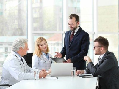 Doctors and Business People discussing in a board room