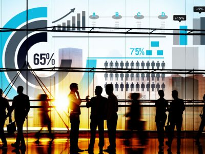 Silhouette of multiple business people in office with data graphics around image