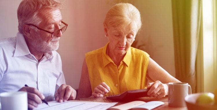 Elderly couple looking over paperwork