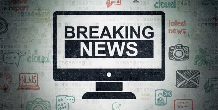 Icon of computer screen with Breaking News text inside and social media icons surrounding background