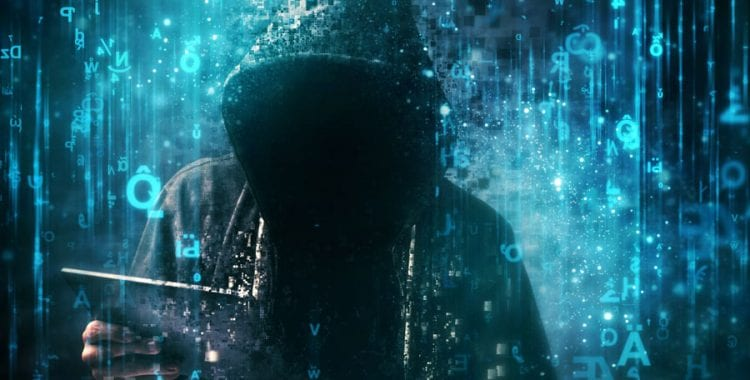 Hacker in hood surrounded by blue code