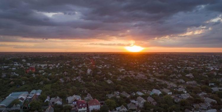 Sunset over community