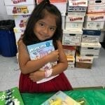 Book Fairies Child Holding up Book from Book Fair