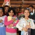 Book Fairies Children Holding up Books from Book Fair