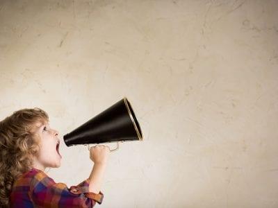 child speaking into megaphone