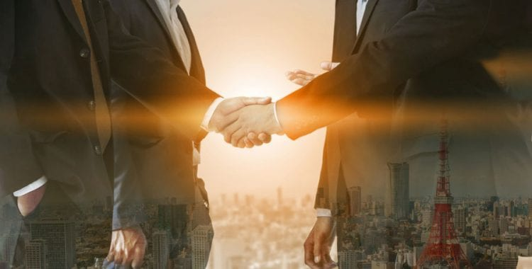 Business People Shaking Hands with city overlay