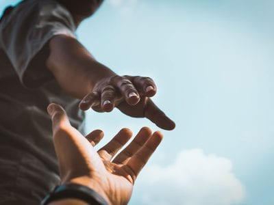 COVID-19: How to Help from Behind Closed Doors-reaching hand out