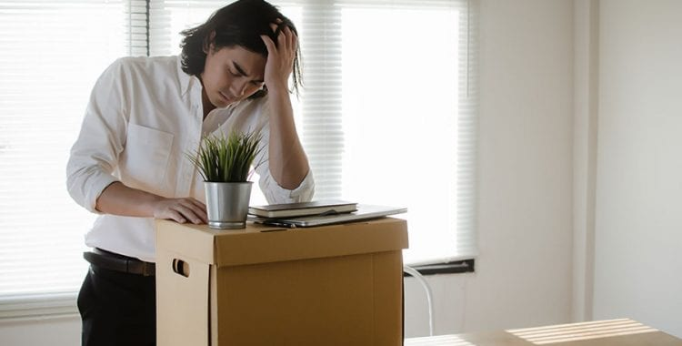 The Coronavirus and Nonprofit Unemployment-Man upset packing desk