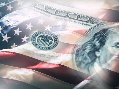 Tax Changes due to Coronavirus-American Flag with money overlay